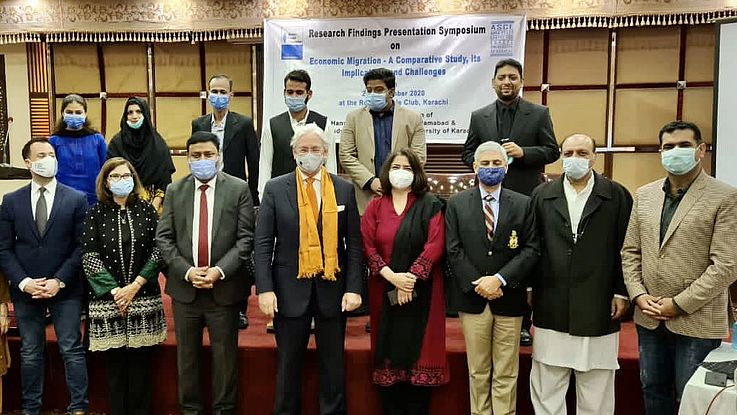 Participants at the economic migration research findings presentation symposium in Karachi